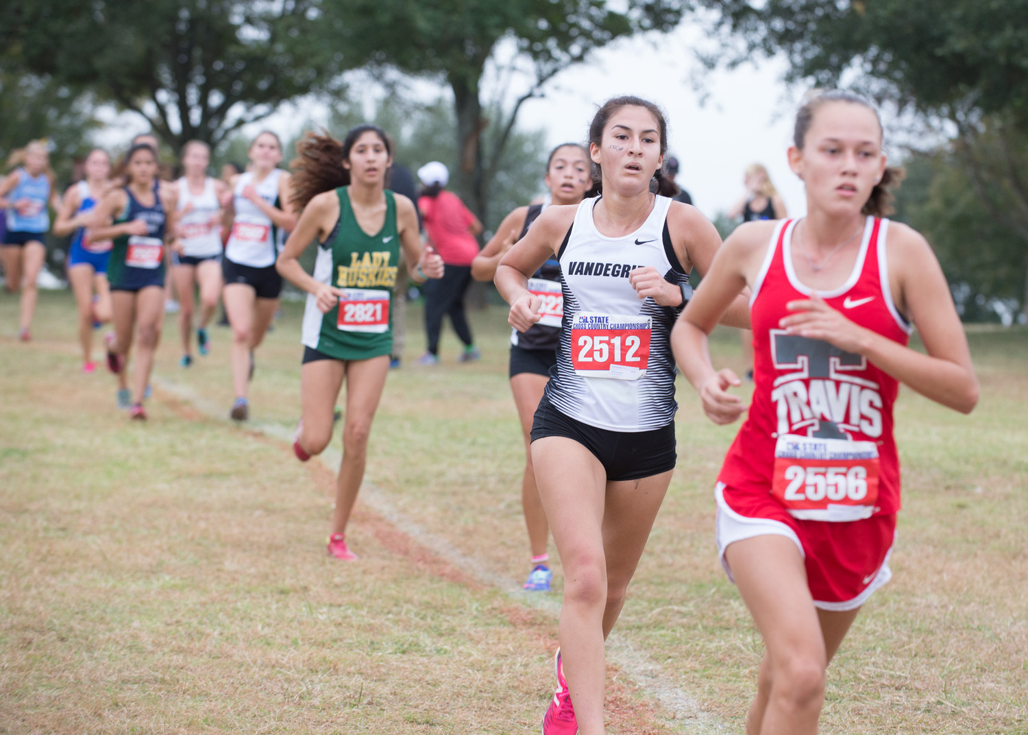 Brianna Garza of Vandegrift High School runs in the UIL Cross Country State Meet at Old Settlers Park in Round Rock, Texas, on Saturday, Nov. 4, 2017. Garza finished the Class 6A girls race with an overall time of 19:37.24.