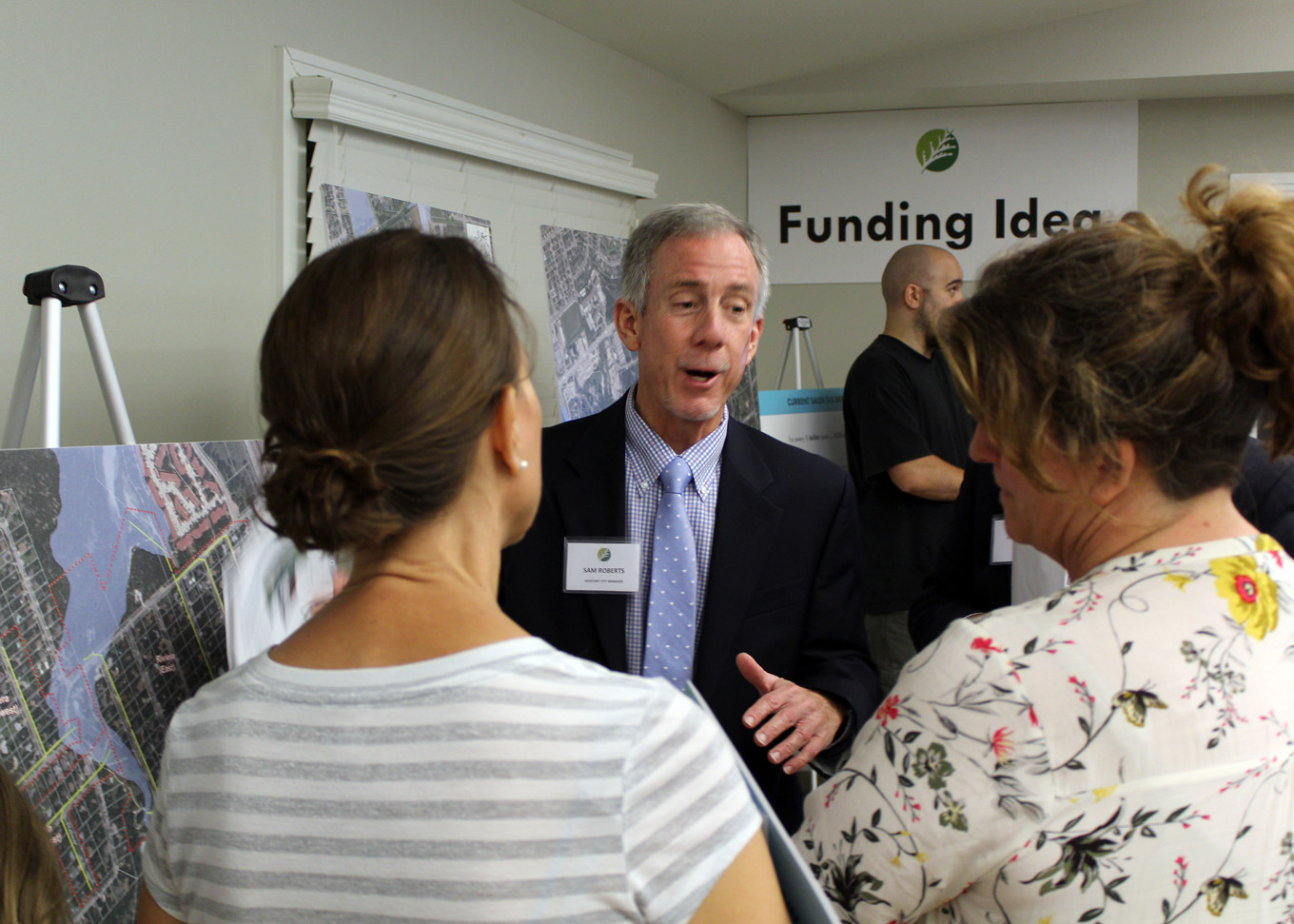 Cedar Park Assistant City Manager Sam Roberts discusses a dedicated stormwater drainage program proposal with residents of Riviera Springs during a town hall meeting, Monday Nov. 6.