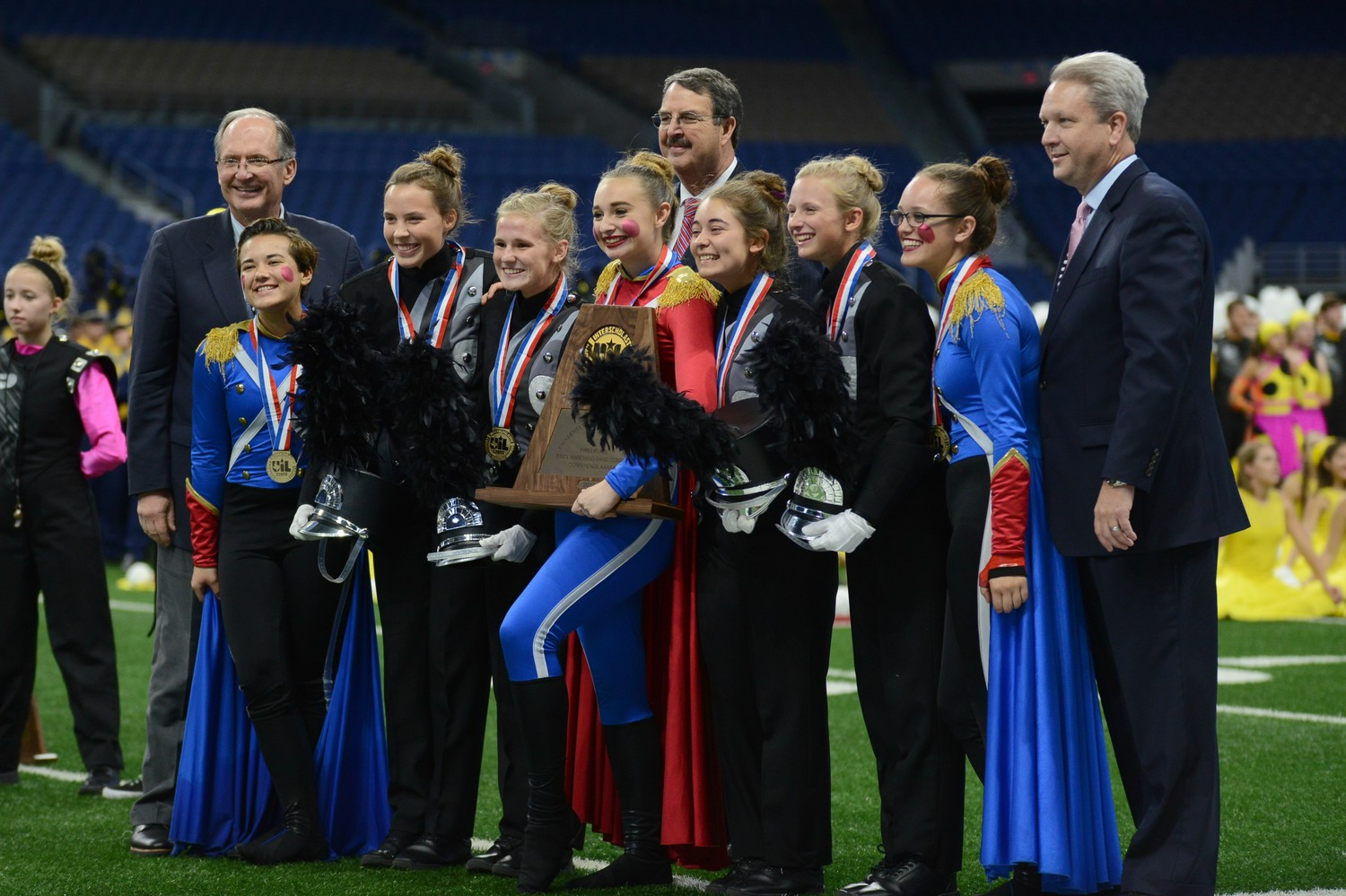The Cedar Park High School marching band accepts their UIL State Marching Band Championship award at the Alamodome, Nov. 8.