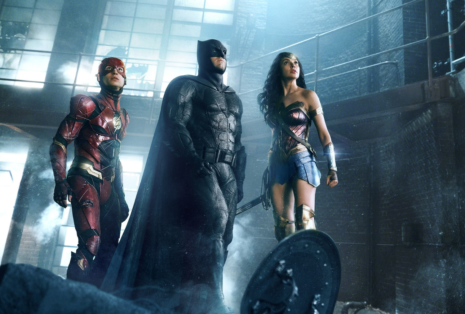 "The Flash (Ezra Miller), left, Batman (Ben Affleck) and Wonder Woman (Gal Gadot) and others come together for their heroic duty in ""Justice League."""