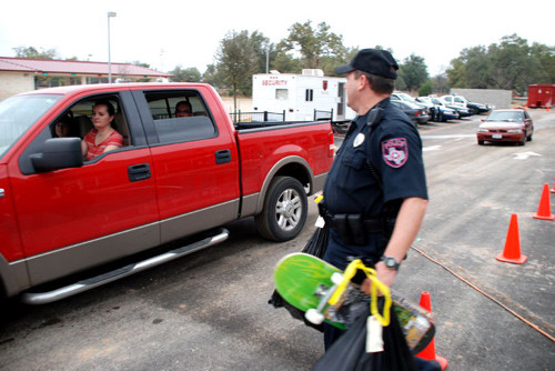 Blue Santa helpers with the Leander Police Department load up trucks with donated toys for families during a Blue Santa distribution day.