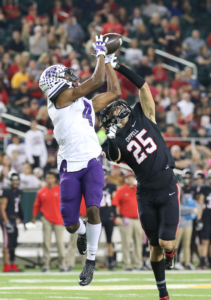 Cedar Ridge Raiders junior wide receiver Jaylen Ellis (4) brings in a touchdown pass over Coppell Cowboys junior free safety Justin Murray (25) during a high school football playoff game between the Cedar Ridge Raiders and the Coppell Cowboys at McLane Stadium in Waco, Texas on December 2, 2017.