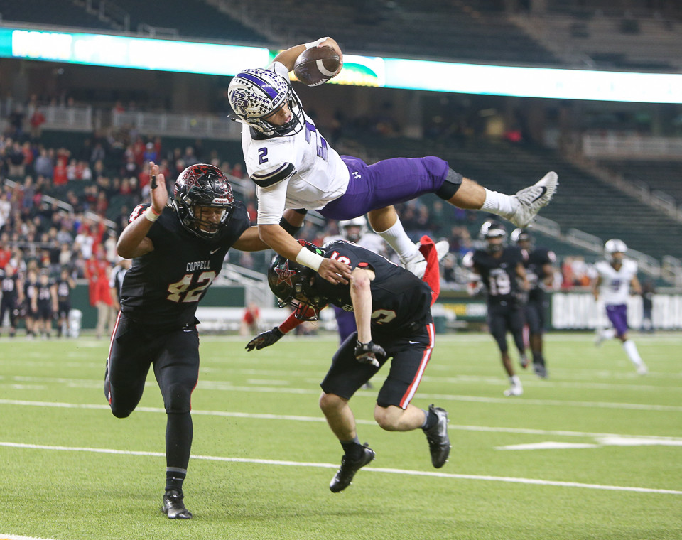 Cedar Ridge Raiders senior quarterback Ezekiel Coss (2) leaps into the end zone for the game-winning score after catching a throwback pass in overtime during a high school football playoff game between the Cedar Ridge Raiders and the Coppell Cowboys at McLane Stadium in Waco, Texas on December 2, 2017.