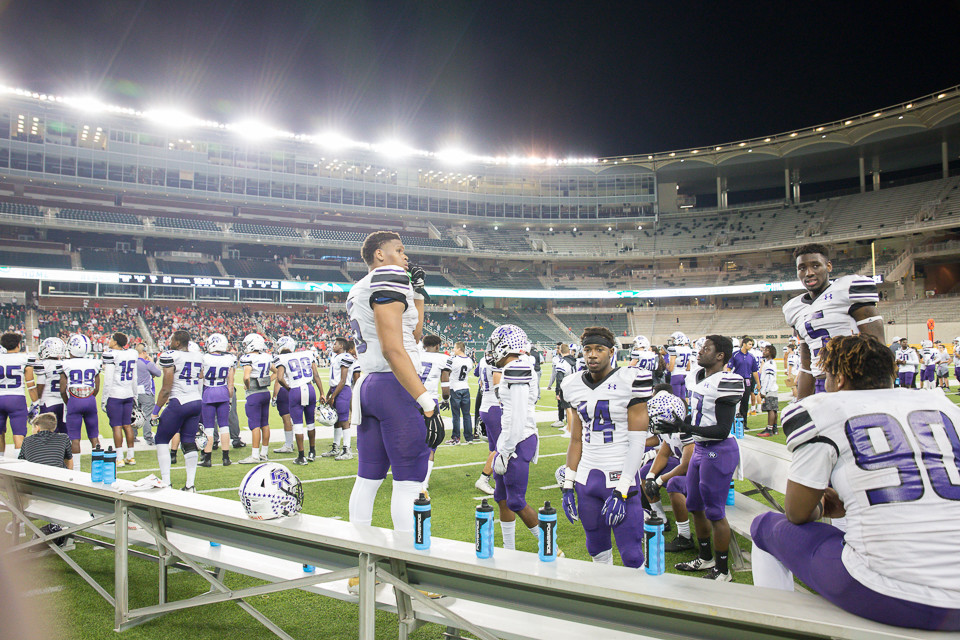 The Cedar Ridge Raiders bench area during the fourth quarter of a high school football playoff game between the Cedar Ridge Raiders and the Coppell Cowboys at McLane Stadium in Waco, Texas on December 2, 2017.