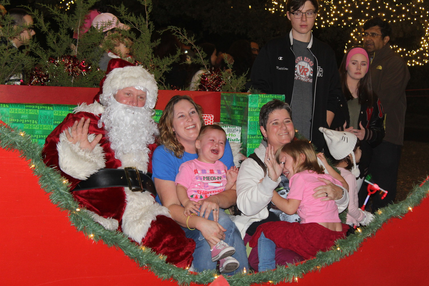 Families pose with Santa during Cedar Park's Santa's Workshop, Dec. 1, 2017.