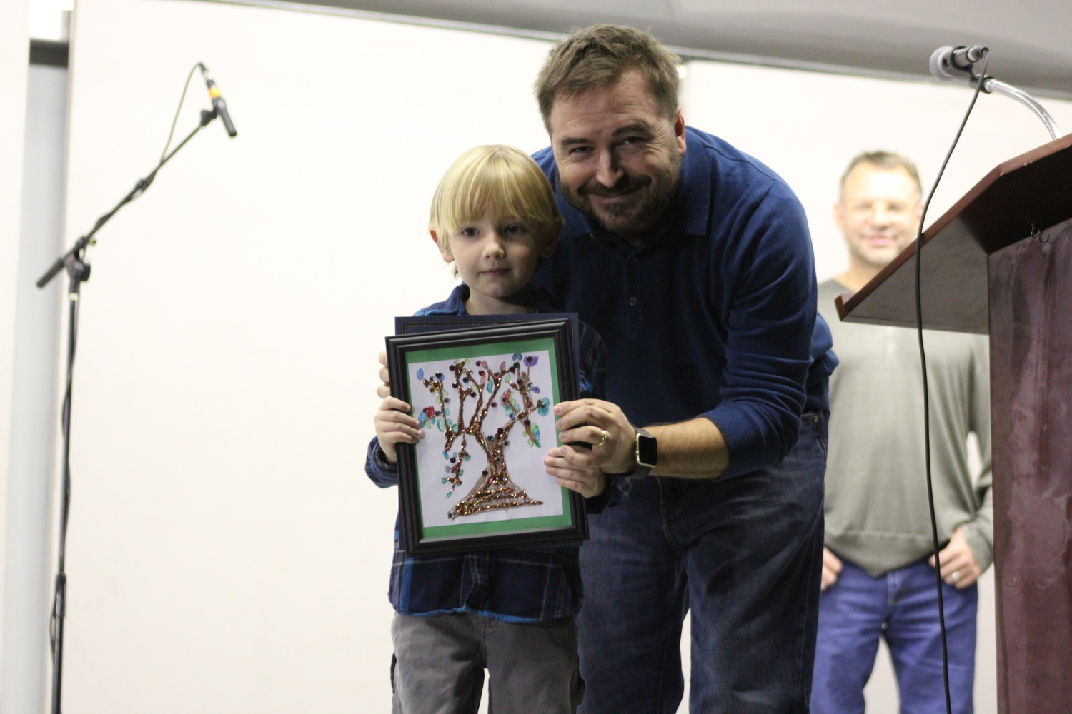 James King, second place winner of the Tree Coloring Contest poses with Cedar Park Mayor Matt Powell.