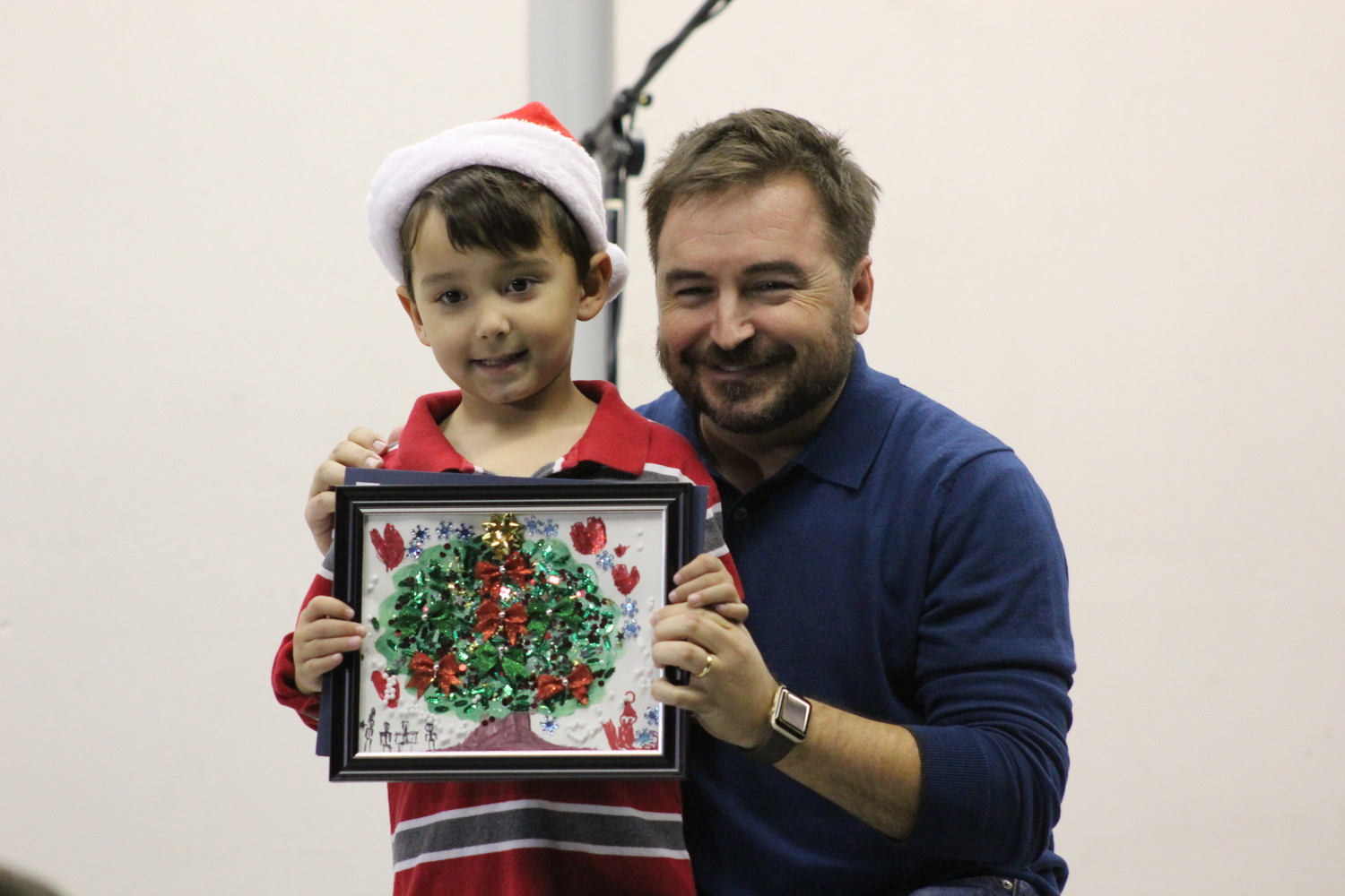 Lucas Rupp, first place winner of the Tree Coloring Contest poses with Cedar Park Mayor Matt Powell.