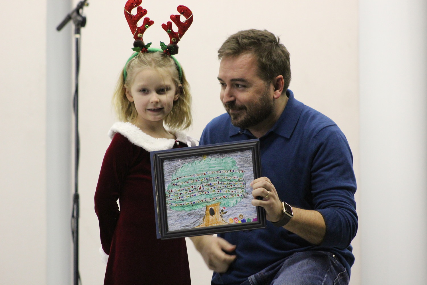 Jemma Smith, third place winner of the Tree Coloring Contest poses with Cedar Park Mayor Matt Powell.