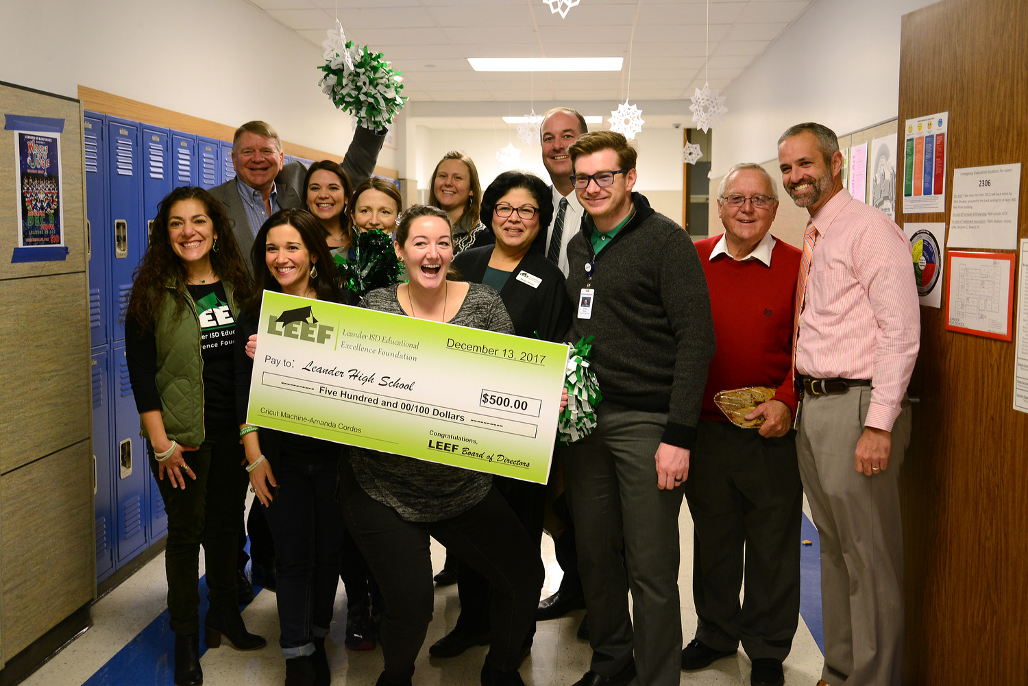 Leander High School teacher Amanda Cordes (center) stands among LISD staff with her $500 grant from the Leander Educational Excellence Foundation to buy a Cricut machine for her art and design classes, Dec. 13.