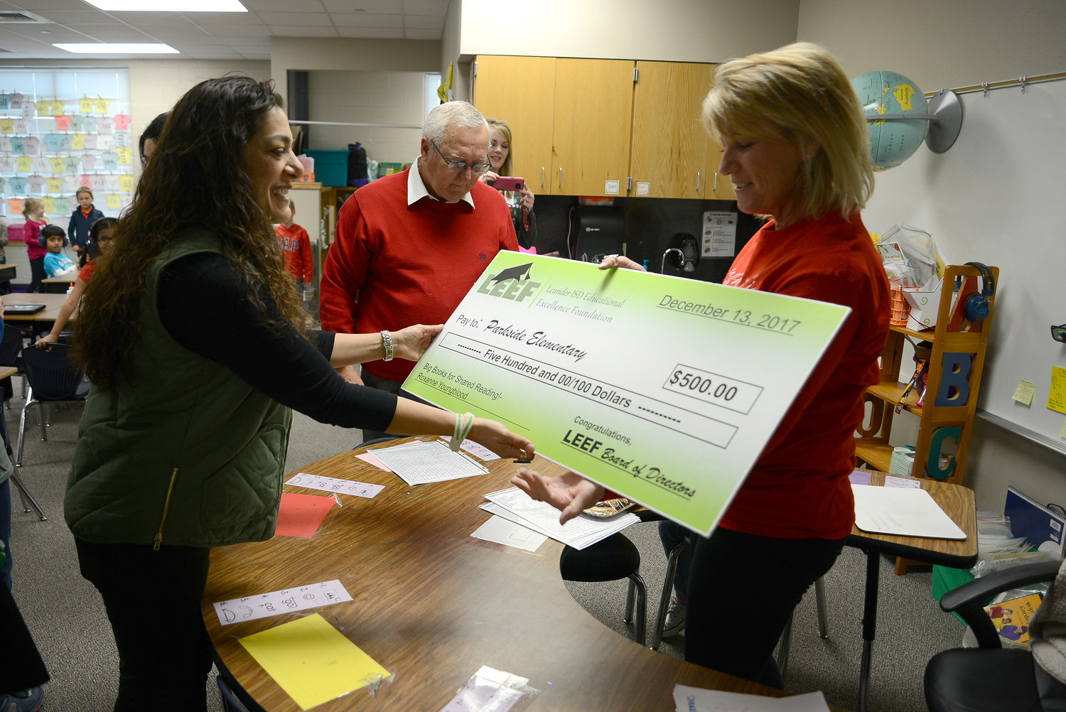 "Parkside Elementary teacher Roxanne Youngblood receives a $500 grant from the Leander Educational Excellence Foundation for her program, ?""?Big Books for Shared Reading!"" on Dec. 13."