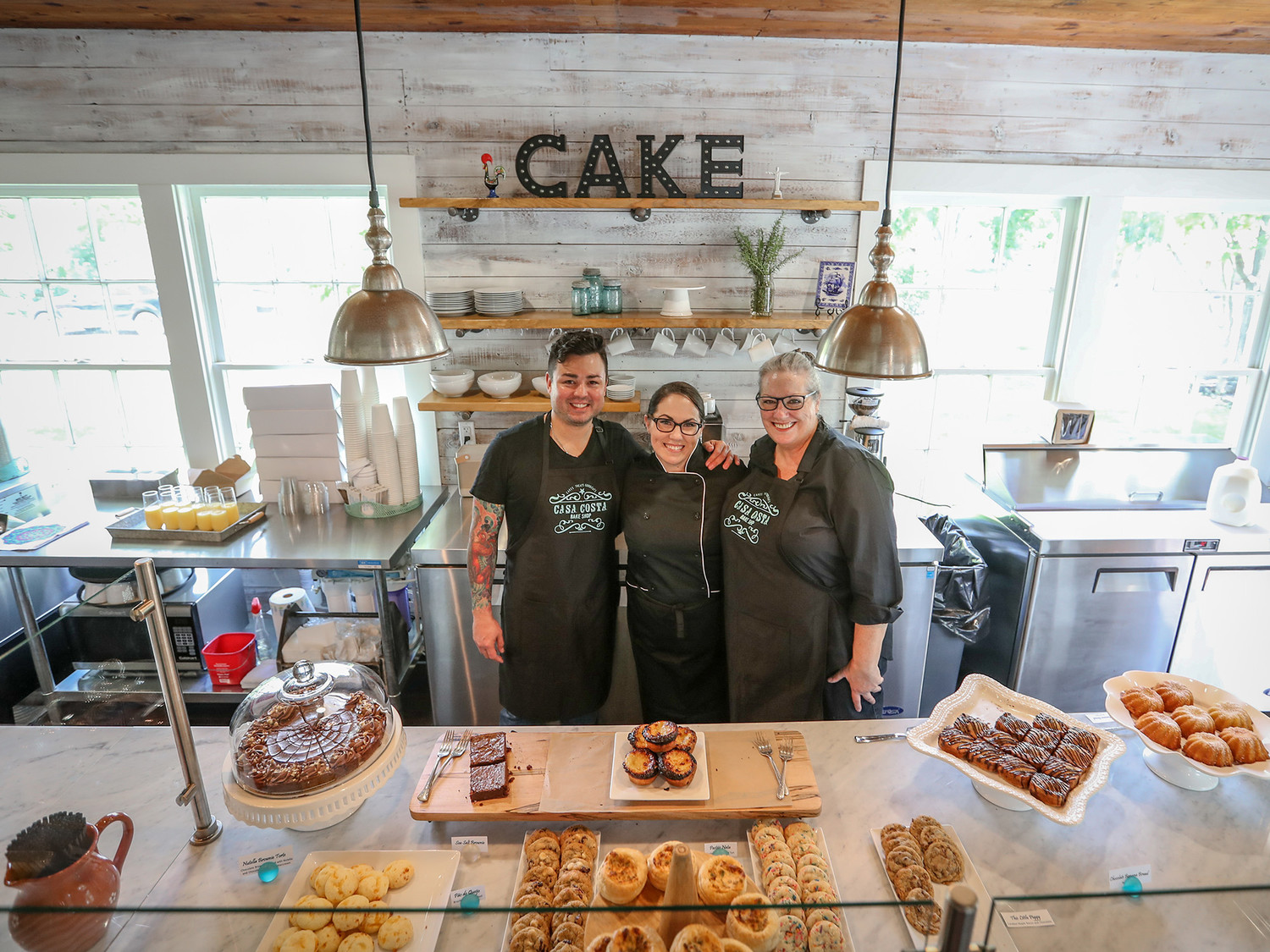 Linda Costa (center) stands among her employees during the grand opening of Casa Costa Bake Shop during their grand opening in August 2017.