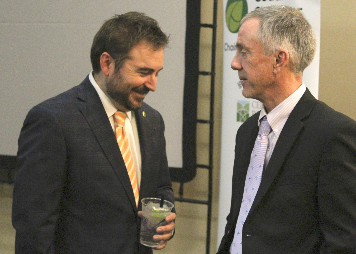 Mayor Matt Powell talks with assistant city manager Sam Roberts after the mayor's state of the city speech, where he announced he won't be seeking re-election, Wednesday, Jan. 10.