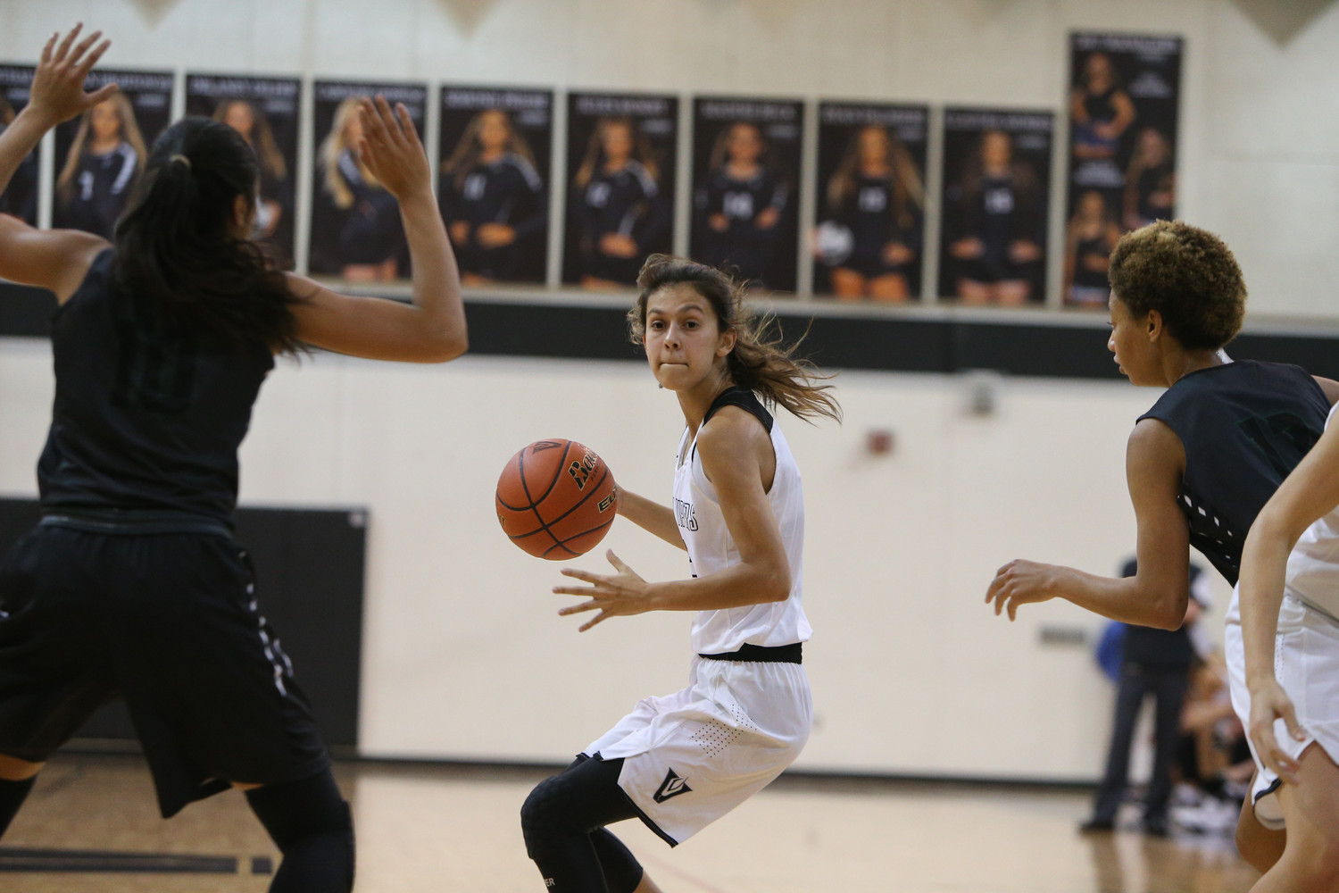 Vandegrift Vipers point guard Bee Gonzales (2) looks to pass during a girls high school basketball game between the Vandegrift Vipers and the Cedar Park Timberwolves at Vandegrift High School in Austin, Texas on Nov. 14, 2017.
