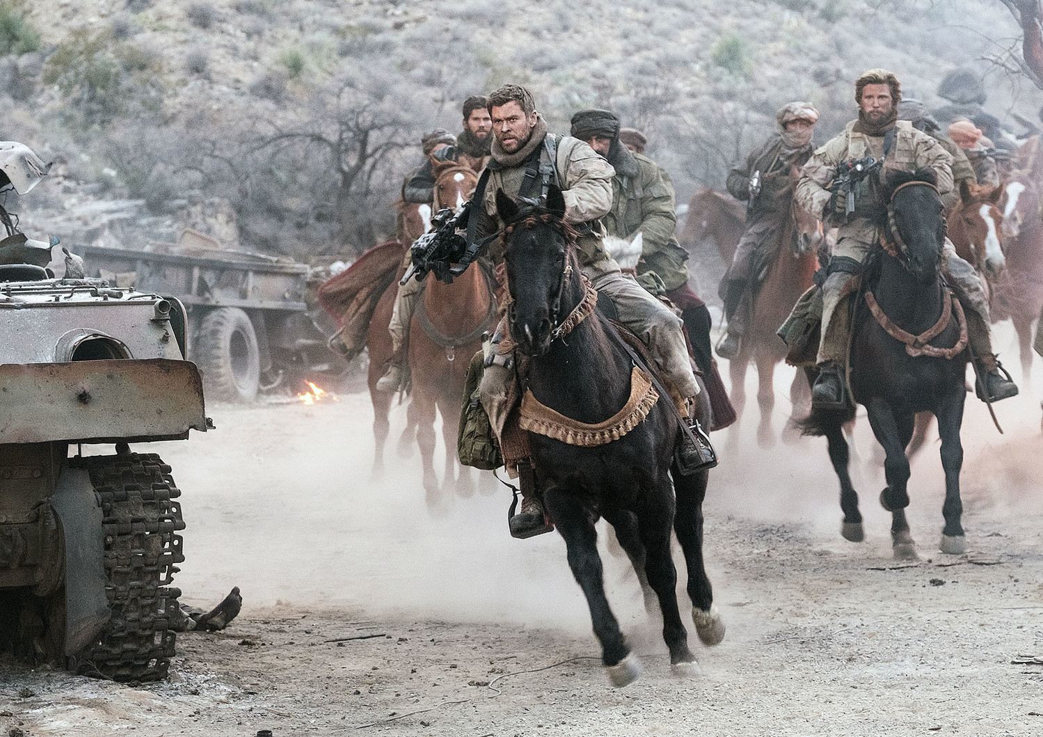 "(Front left) Chris Hemsworth as Captain Mitch Nelson and Thad Luckinbill as Vern Michaels star in the war drama ""12 STRONG,"" a Warner Bros. Pictures release."
