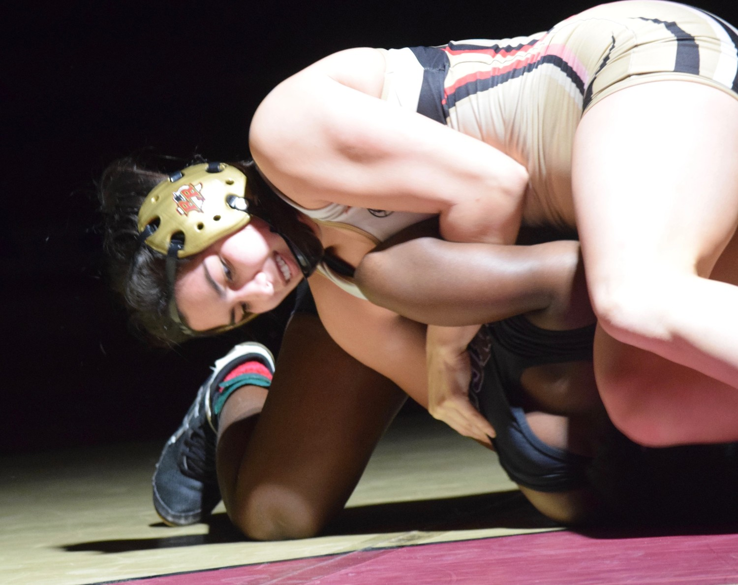 Rouse senior Alex Elias had no idea what wrestling was when she got to high school. Four years later, she's aiming to go to the state tournament for her second straight year.