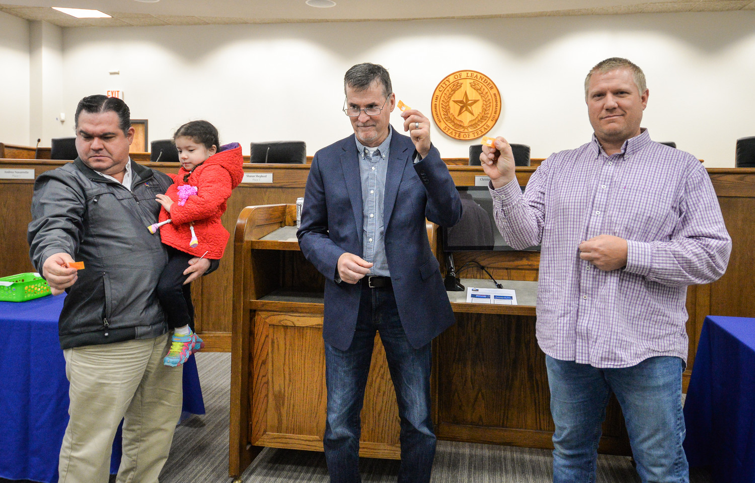 City of Leander mayoral candidates (left to right) Vic Villarreal, Troy Hill and Adam Benefield drew straws for ballot position at the Leander City Council chamber on February 22