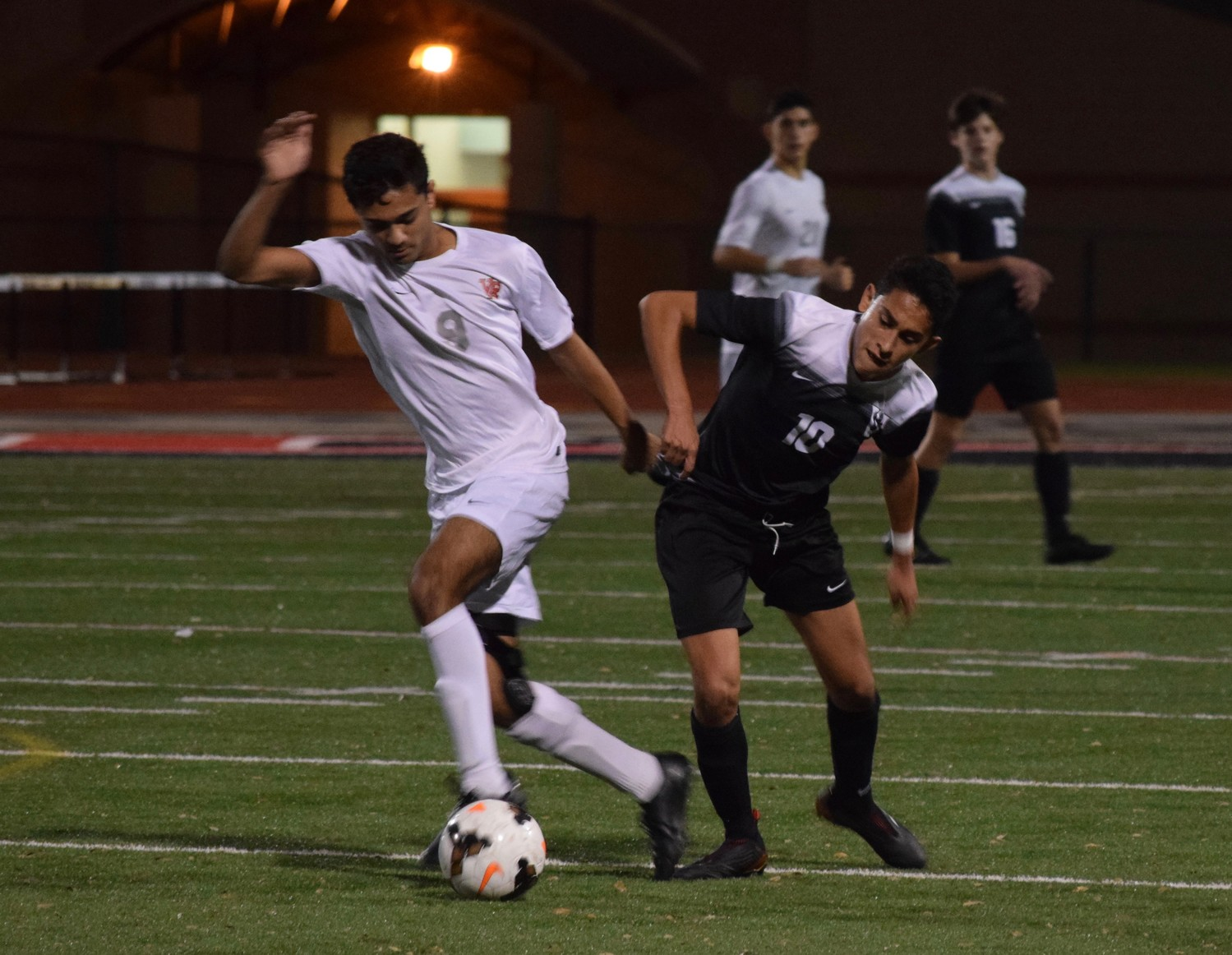 Keshav Naick, left, of Vista Ridge and Juan Gonzalez of Vandegrift battle for the ball during a district game Tuesday night at Vista Ridge High School. The Rangers won 3-2.