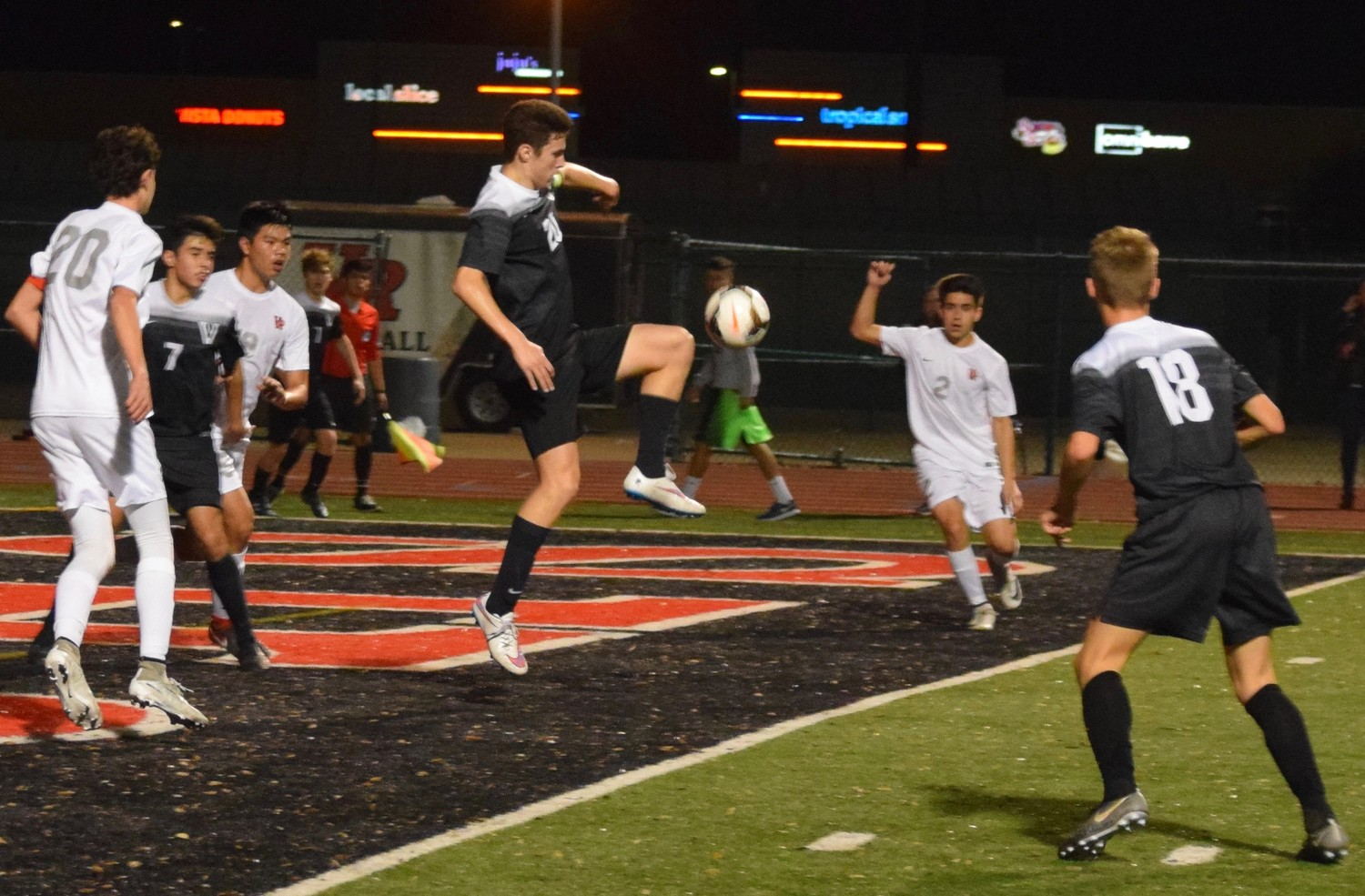 Tadhg McDaid volleys the during a district game Tuesday night at Vista Ridge High School. The Rangers won 3-2.