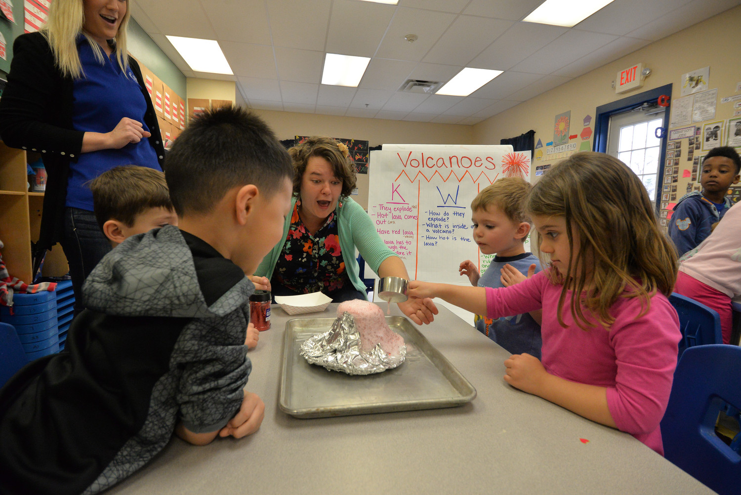 Goddard School students learn about volcanos by using common household products to create a bubbly eruption.