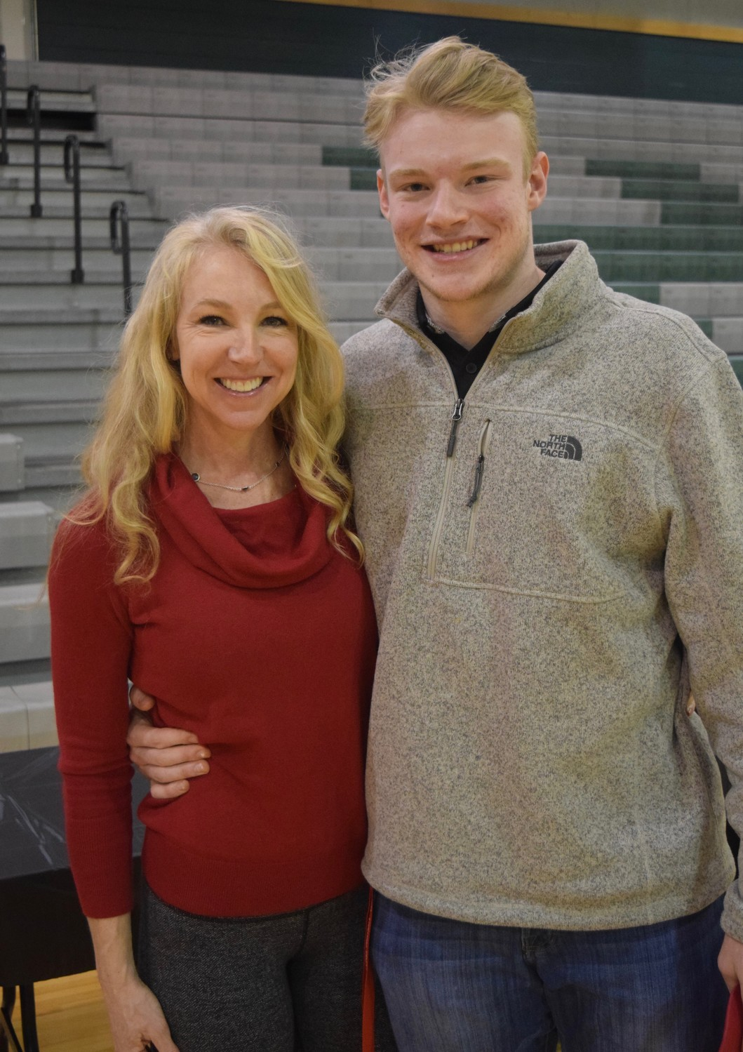 Hayley Brooks, left, and her son, Cedar Park football and basketball player Mason Brooks after Mason signed to play football at Western Kentucky.