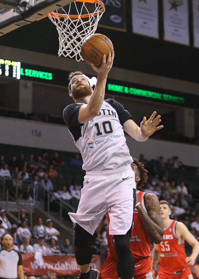 Austin Spurs forward Matt Costello (10) looks in a reverse layup during the second-round NBA G-League playoff game between the Austin Spurs and the Rio Grande Valley Vipers at H-E-B Center in Cedar Park, Texas, on April 2, 2018.
