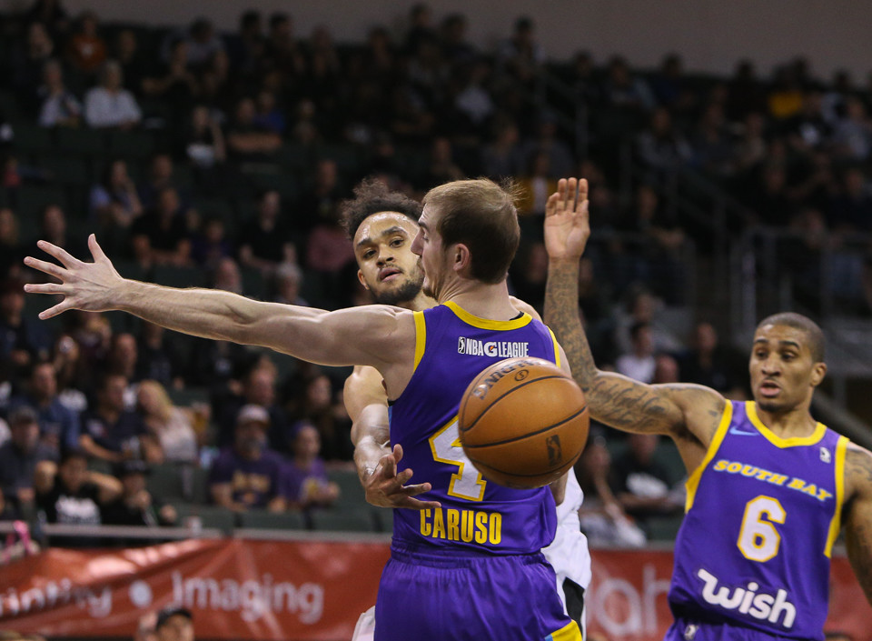 Austin Spurs guard Derrick White (4) passes the ball under the arm of South Bay Lakers guard Alex Caruso (4) during the NBA G-League West Conference Finals between the Austin Spurs and the South Bay Lakers at H-E-B Center in Cedar Park, Texas, on April 5, 2018.