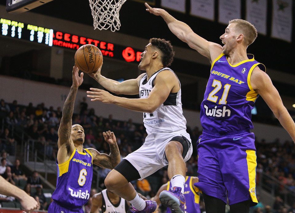 Austin Spurs guard Nick Johnson (14) elevates to take a shot under the basket during the NBA G-League West Conference Finals between the Austin Spurs and the South Bay Lakers at H-E-B Center in Cedar Park, Texas, on April 5, 2018.