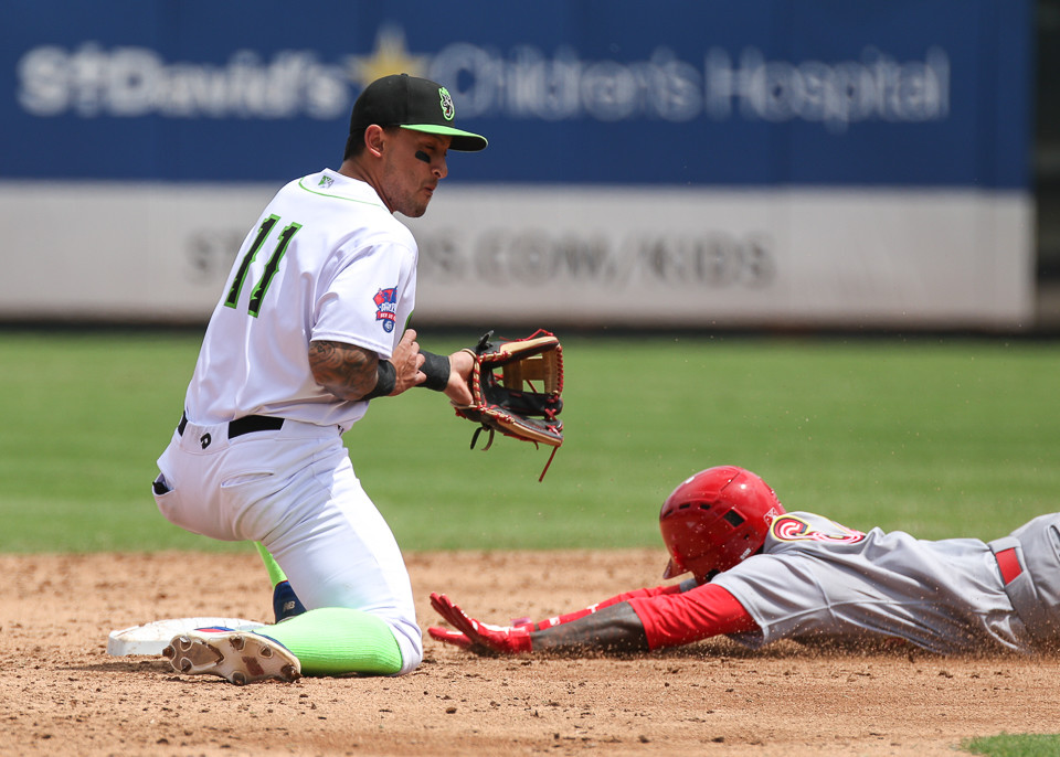 Round Rock Express second baseman Christian Lopes (11) is unable to tag Memphis Redbirds right fielder Adolis Garcia (32) out at second during a Minor League Baseball game between the Round Rock Express and the Memphis Redbirds at Dell Diamond on April 8, 2018.