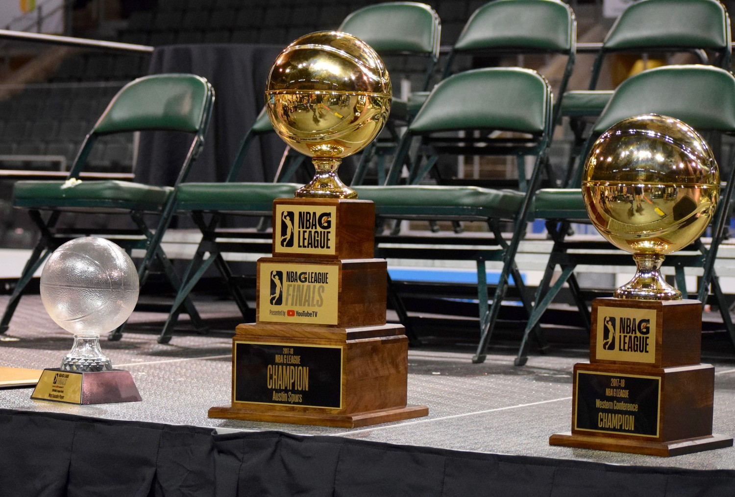 From left: Nick Johnson's Finals MVP Trophy, the NBA G League Championship trophy and the Western Conference Championship.