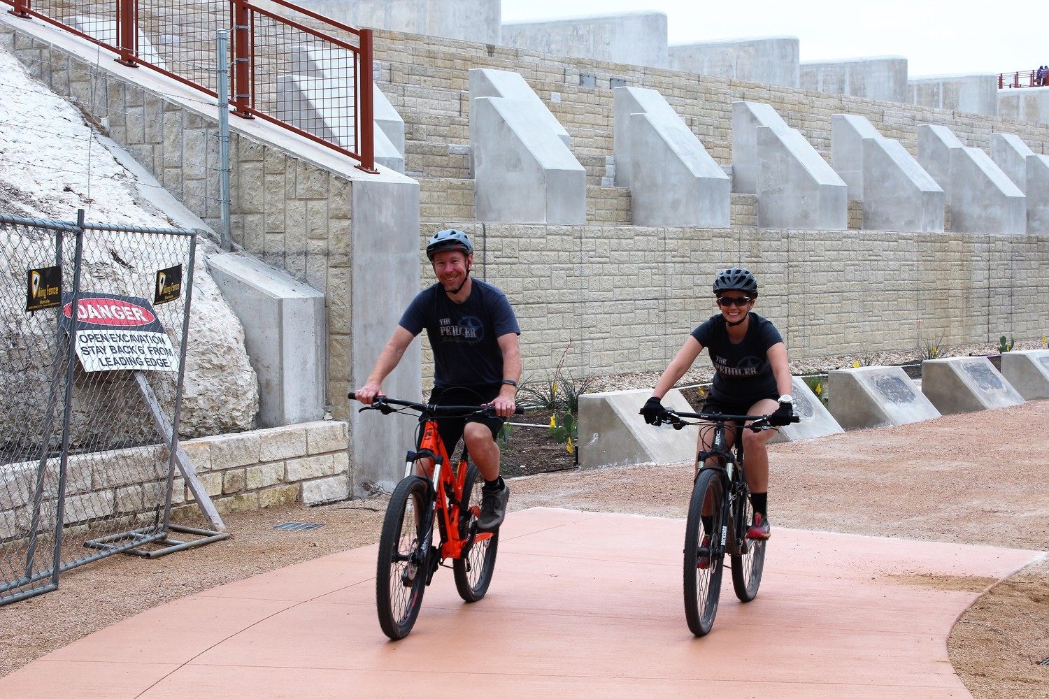 Cyclists ride alongside of the Brushy Creek Dam after it's reopening.