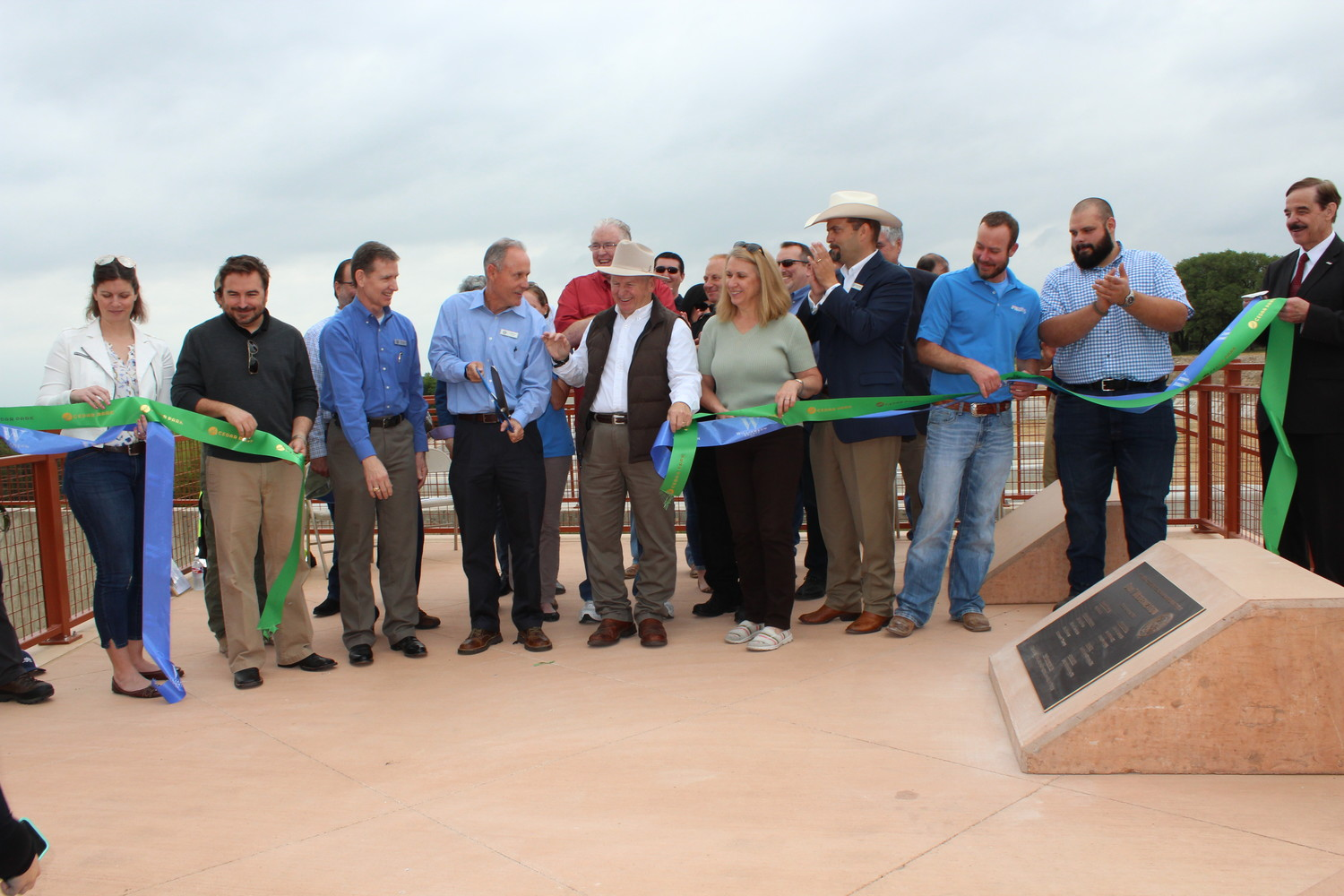 The ribbon cutting for the opening of the newly renovated dam and trails in Brushy Creek Park.