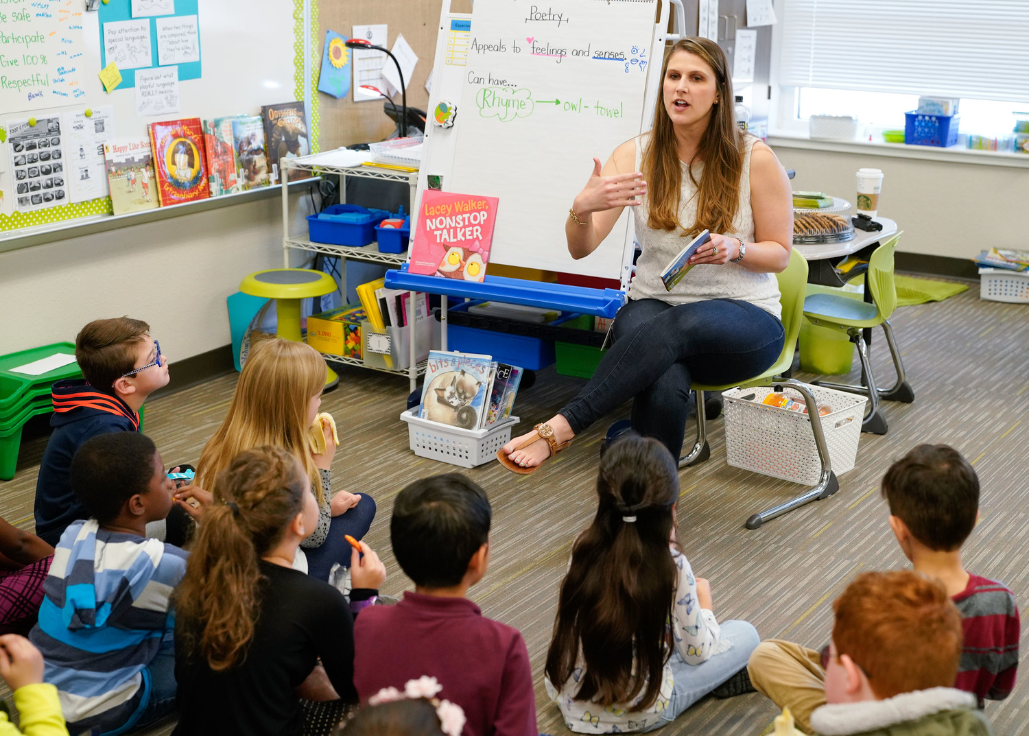 Allie Duffy reads to her class at Joe Lee Johnson Elementary. Duffy was named the Rising Star teacher in the elementary category at the H-E-B Excellence in Education Awards ceremony in Houston on May 6.
