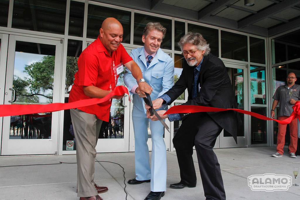 Alamo Drafthouse founder Tim League (center) helps cut the ribbon for the Lakeline Theater opening on Monday, July 22, 2013.