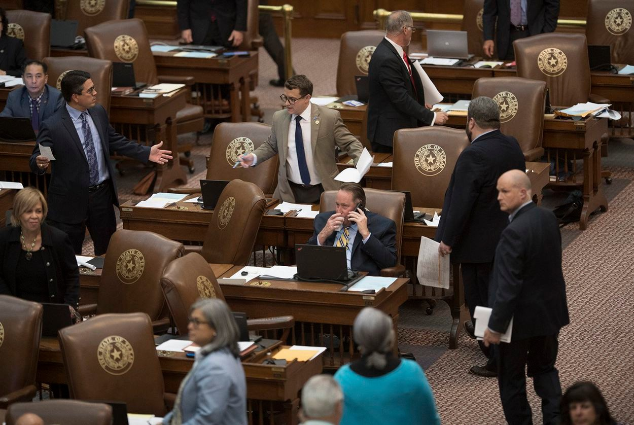 Arguments break out on the floor of the Texas House of Representatives during a recent session.