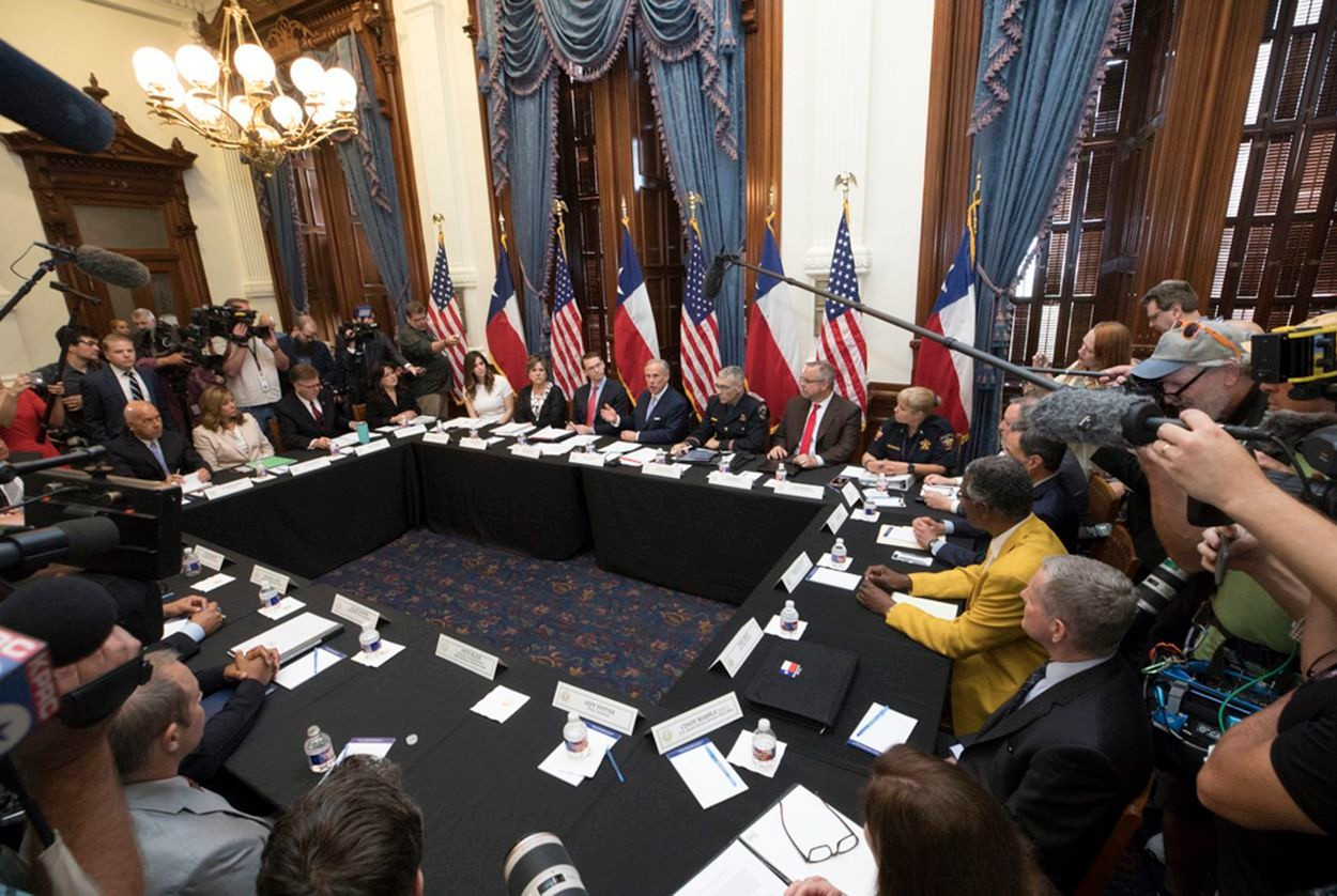 Gov. Greg Abbott (top center, in front of U.S. flag) held the first of three roundtable discussions on school safety in Austin on May 22, 2018, in the aftermath of the Santa Fe high school shooting.