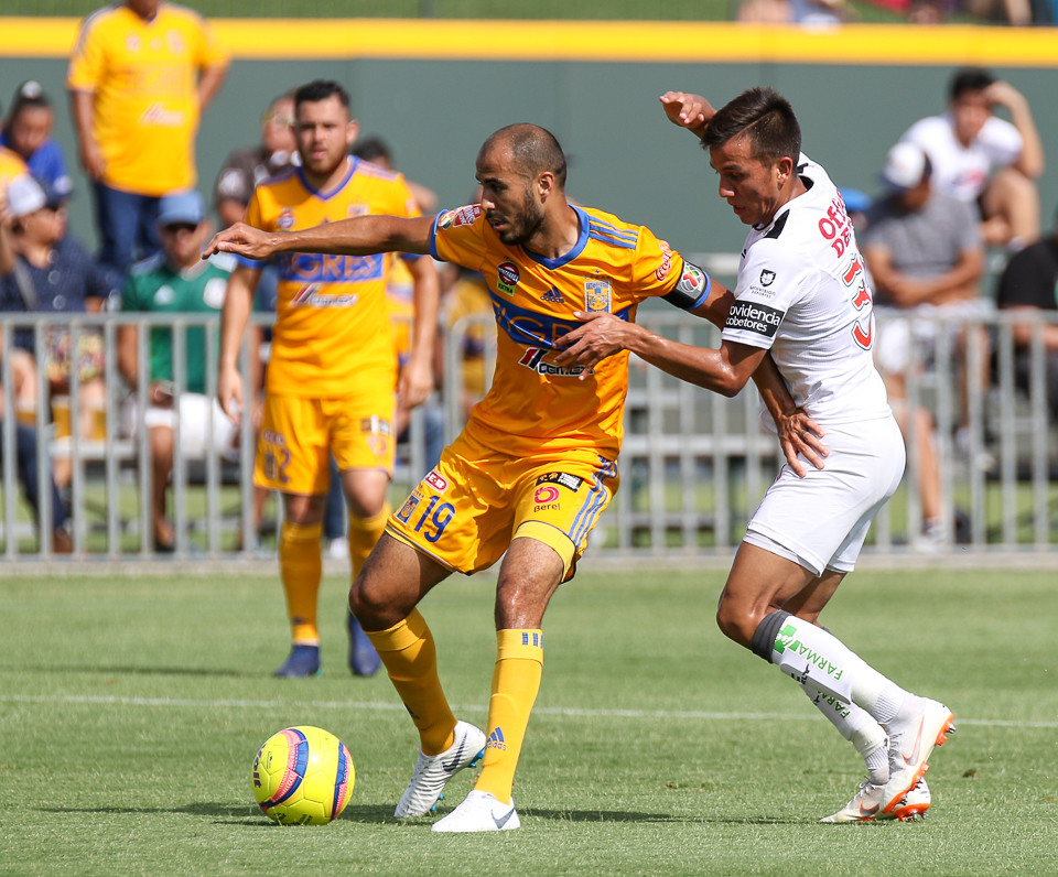 Tigres midfielder Guido Pizarro (19) and Pachuca defender Elbis Sousa (3) fight for possession during a Liga MX friendly match between Tigres and Pachuca at Dell Diamond in Round Rock, Texas, on July 8, 2018.
