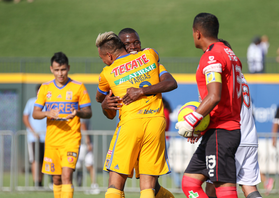 Tigres forward Eduardo Vargas (9) and midfielder Enner Valencia (13) celebrate after scoring a second-half goal during a Liga MX friendly match between Tigres and Pachuca at Dell Diamond in Round Rock, Texas, on July 8, 2018.