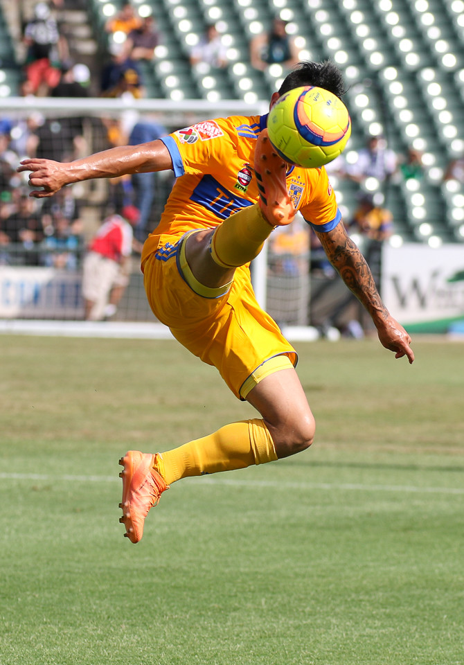 Tigres forward Lucas Zolarayan (8) elevates to kick the ball  during a Liga MX friendly match between Tigres and Pachuca at Dell Diamond in Round Rock, Texas, on July 8, 2018.