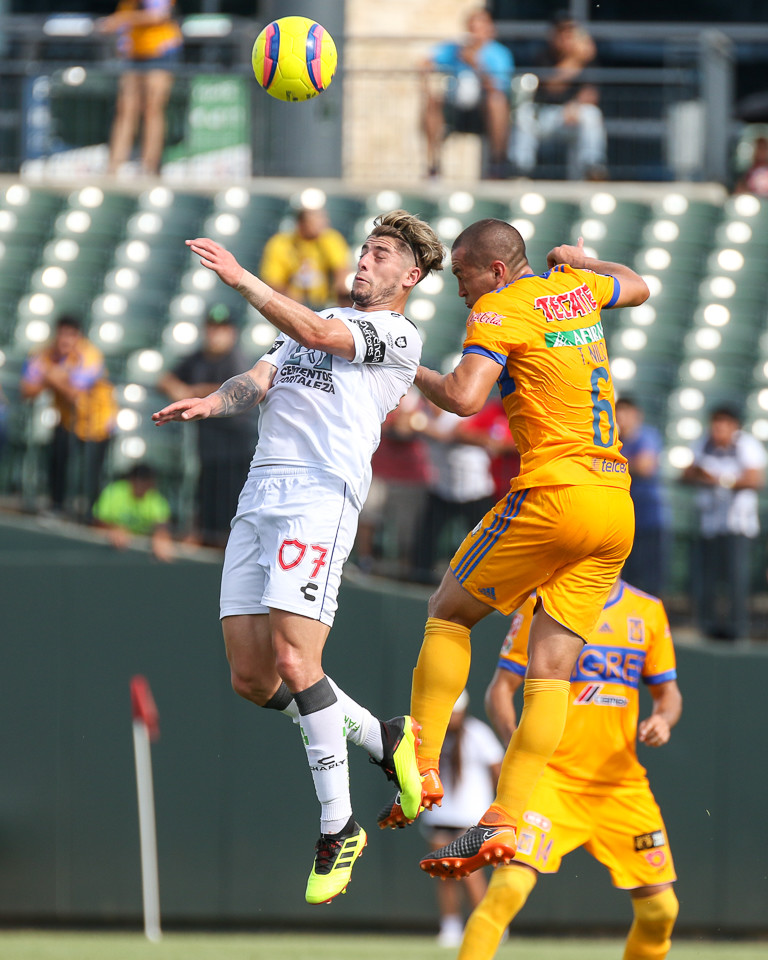 Pachuca midfielder Angelo Sagal (7) and Tigres defender Jorge Torres (6) leap to head the ball during a Liga MX friendly match between Tigres and Pachuca at Dell Diamond in Round Rock, Texas, on July 8, 2018.
