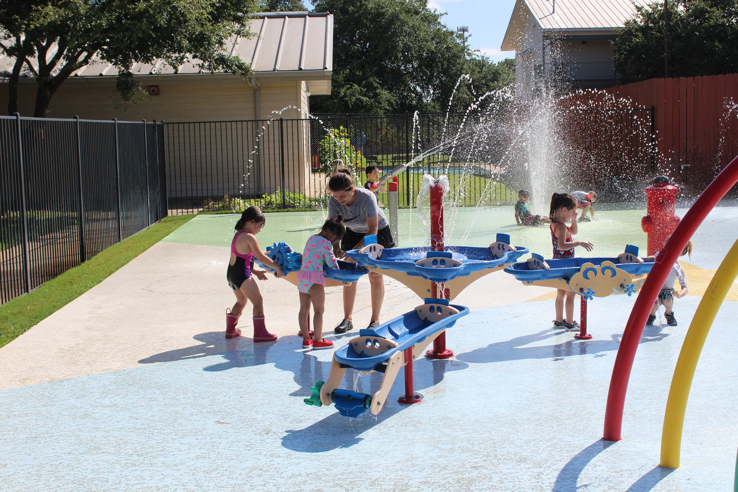 Students enjoy playing at the splashpad at Bluebonnet School of Cedar Park, which recently obtained its eighth accreditation.