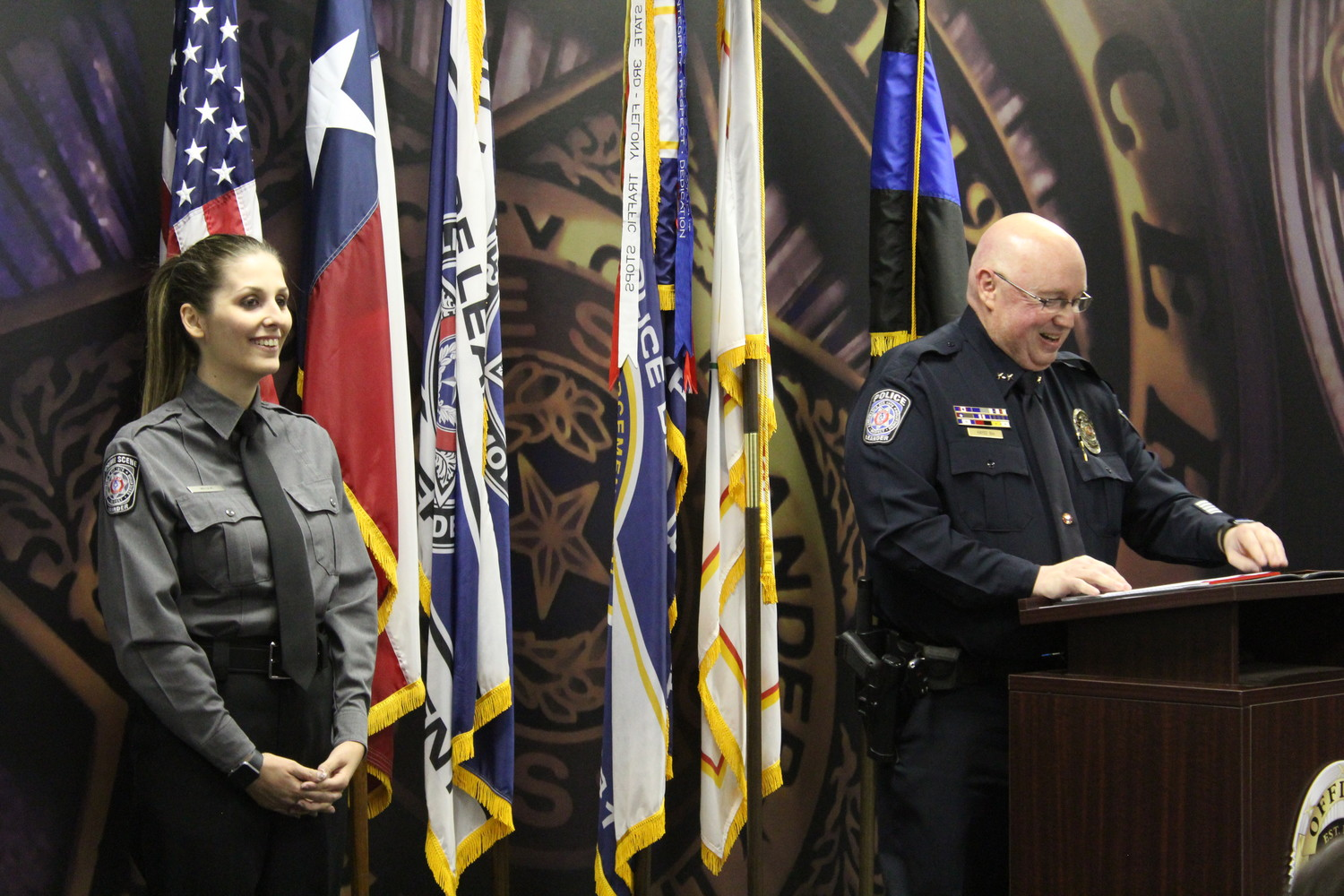 Leander Assistant Chief of Police Jeff Hayes introduces crime scene specialist Haley Williams during a badge-pinning ceremony at the Leander Police Department on July 12.