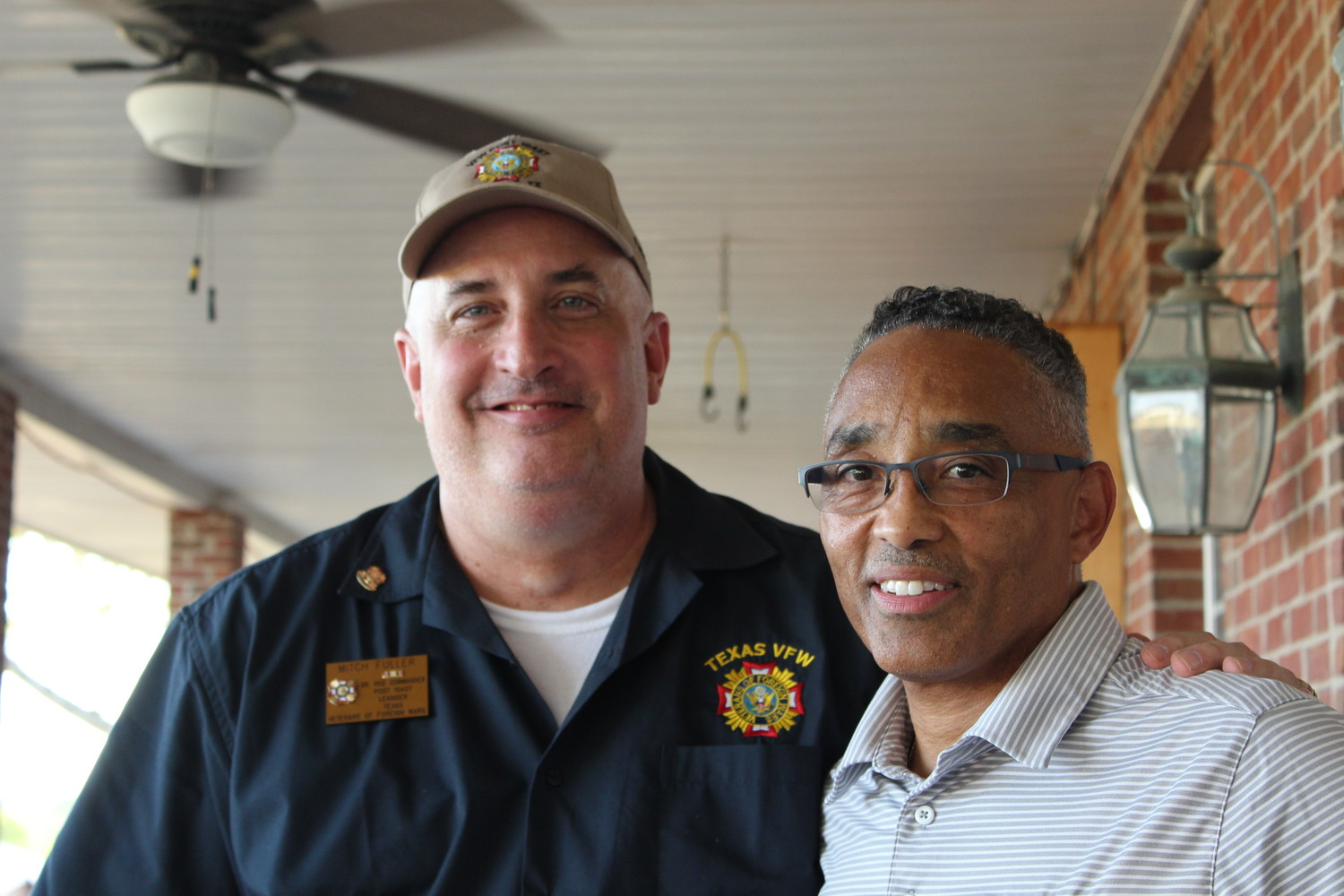 Retired Army Lt. Col Kevin Harris (right) stands with retired Capt. Mitch Fuller, Senior Vice Commander of Leander VFW Post 10427 at the post's steak dinner on July 20.