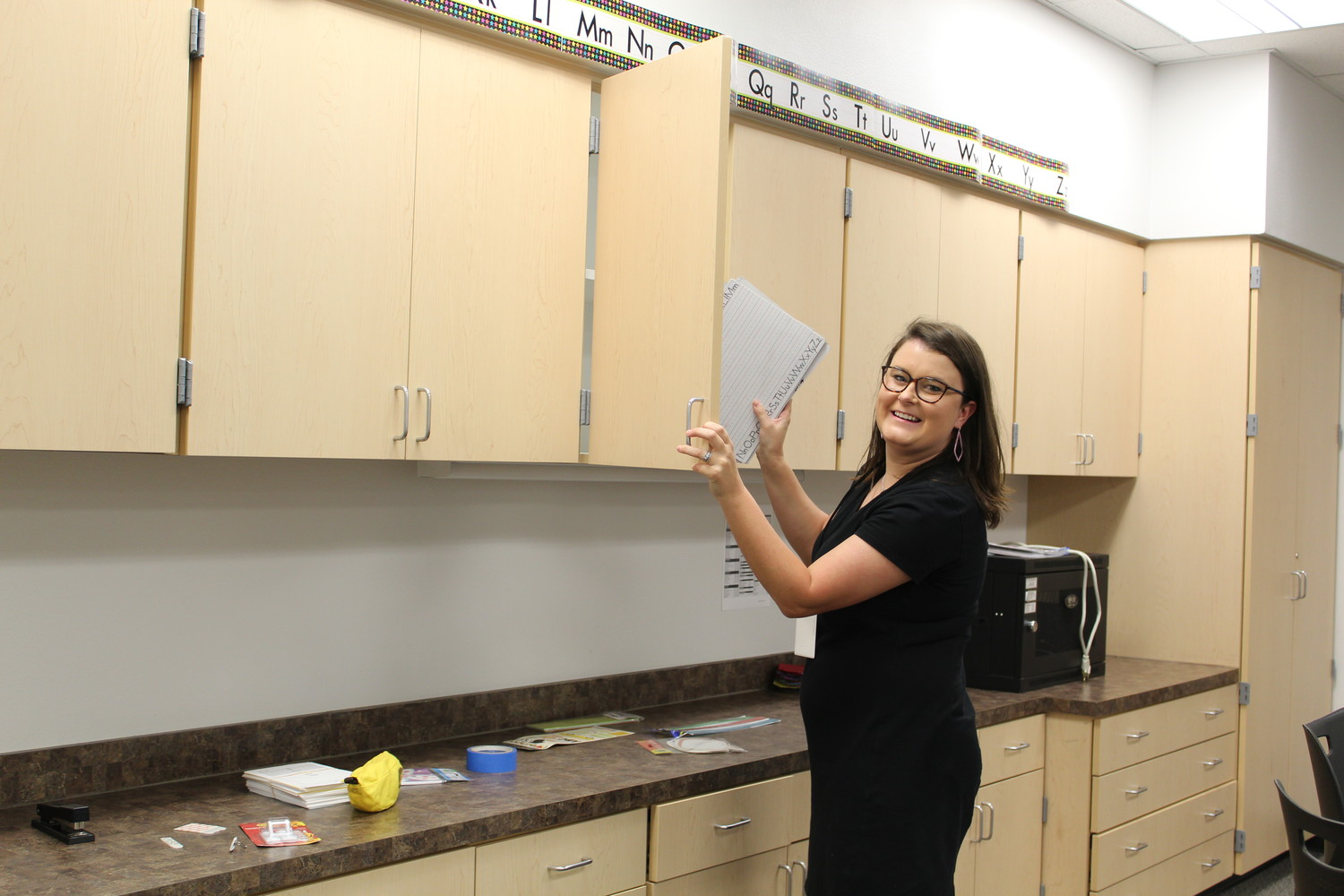 New Camacho Elementary teacher Bailey Ayres assists in set-up of Elinore Ramos' second grade classroom. Ayres will teach all subjects for a first grade classroom.