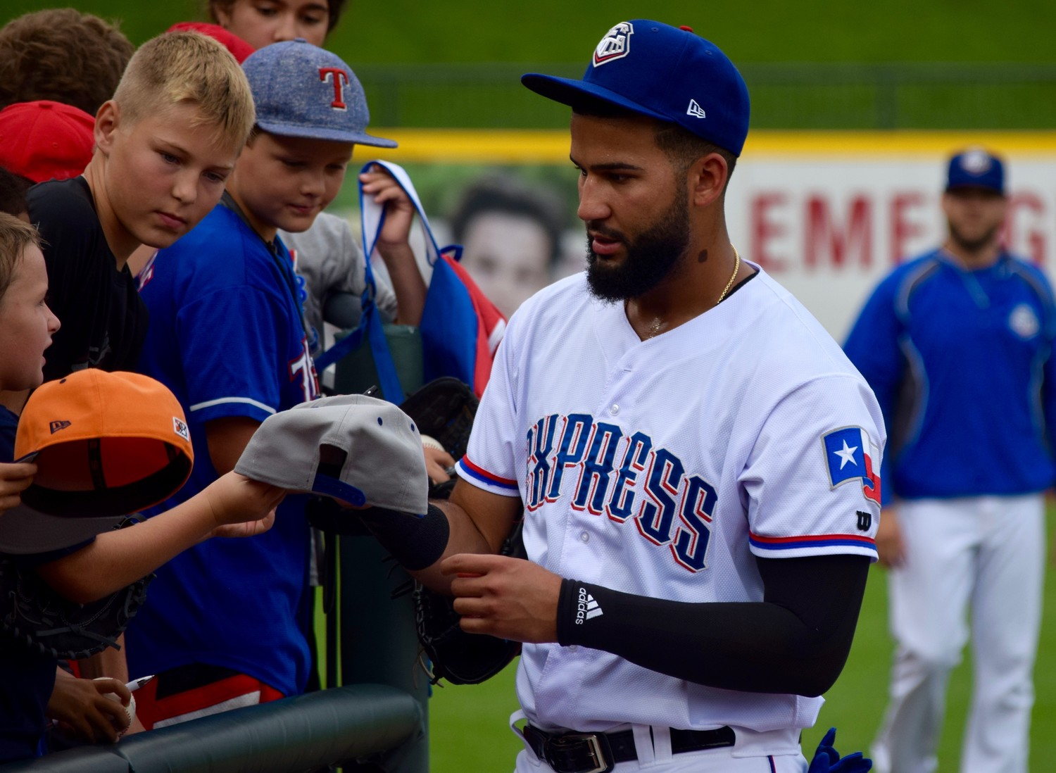 Nomar Mazara, who signed with the Rangers as an international free agent for a then-record $4.95 million and hit a home run in his major league debut, spent pregame on Sunday stretching in the outfield before signing autographs for anybody that asked him.
