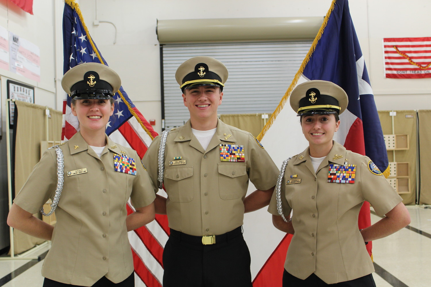 Seventeen-year-old Vista Ridge High School seniors Cailey Grimball, (right) Commanding Officer of the Lone Star Company, Senior Lieutenant Andrew Delaney (middle) and Cadet Senior Chief Petty Officer Sarah Stout.