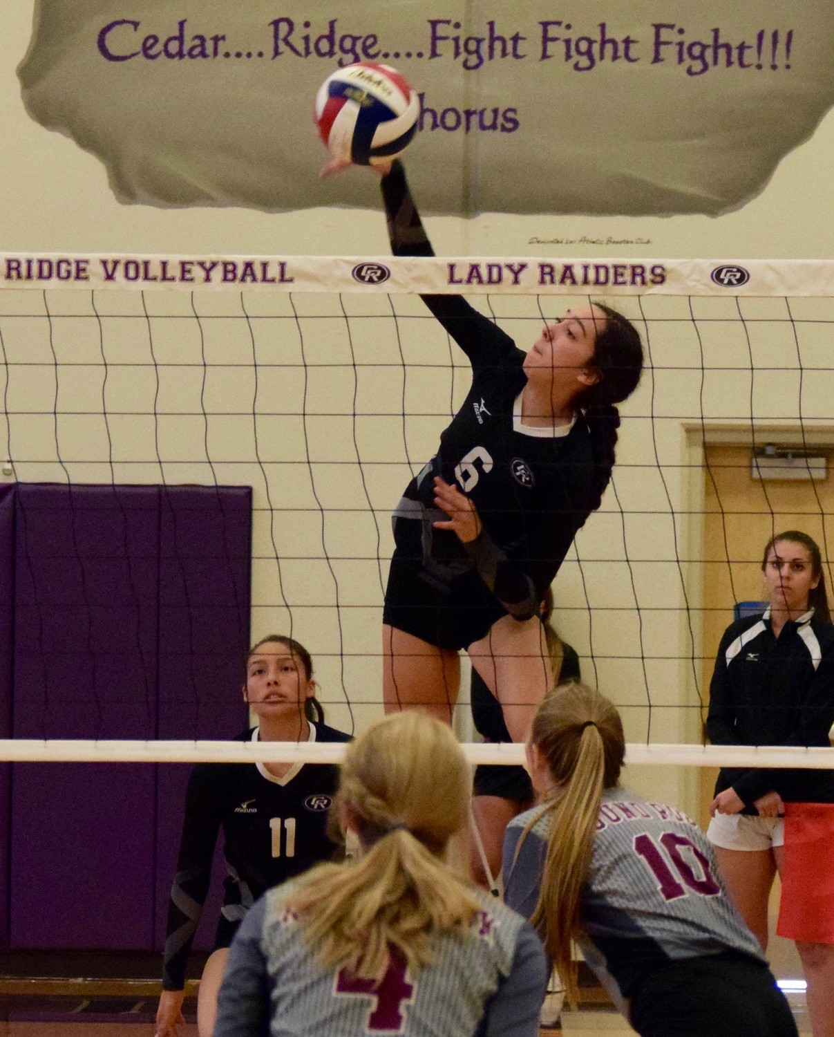 Micayla Harris and Cedar Ridge fell to Round Rock 3-0 (25-22, 25-23, 25-23) in the first game of district 13-6A play on Tuesday night.