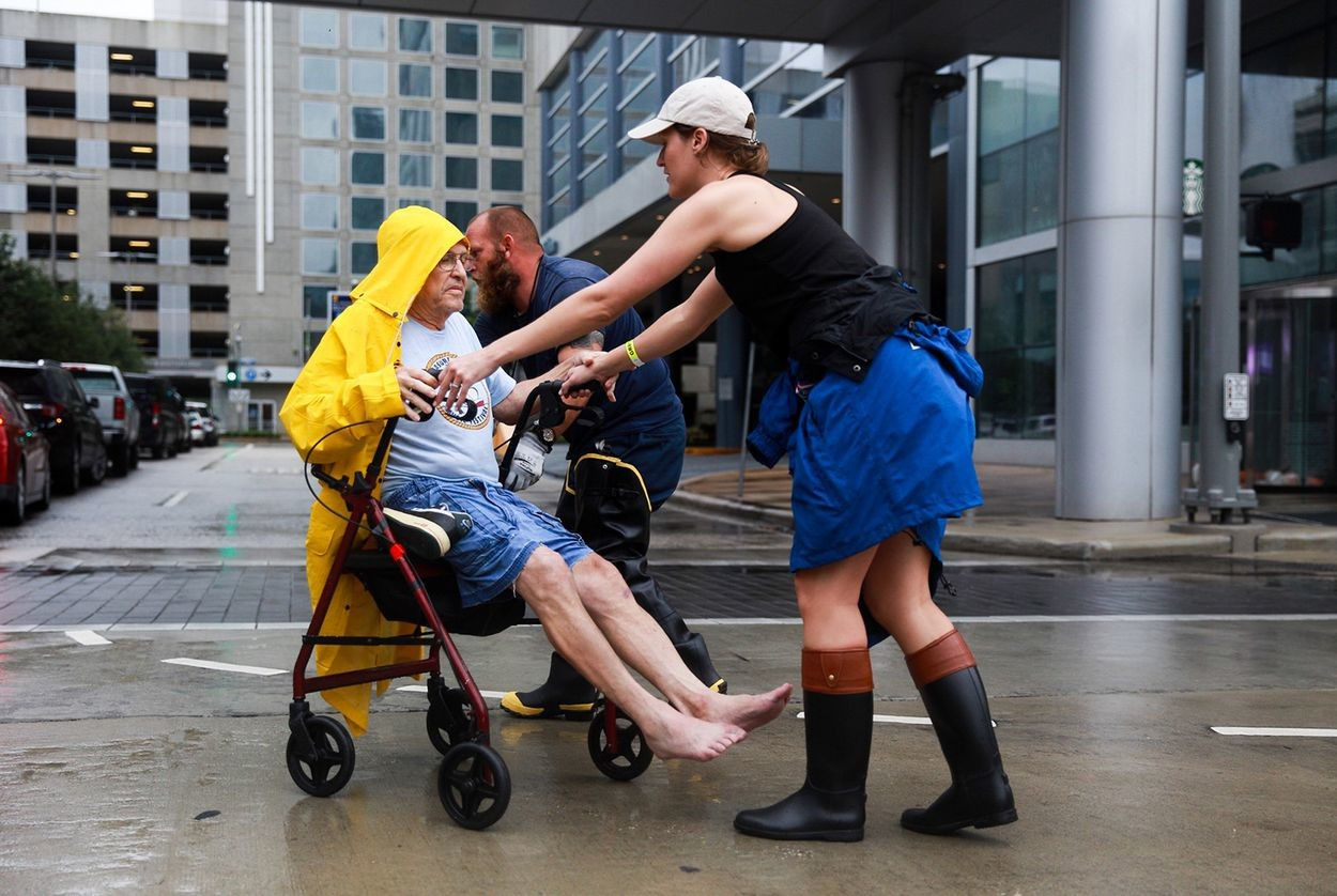An evacuee from Meyerland — a neighborhood in southwest Houston hit hard by Harvey — arrives at the George R. Brown Convention Center on Sunday, Aug. 27, 2017.