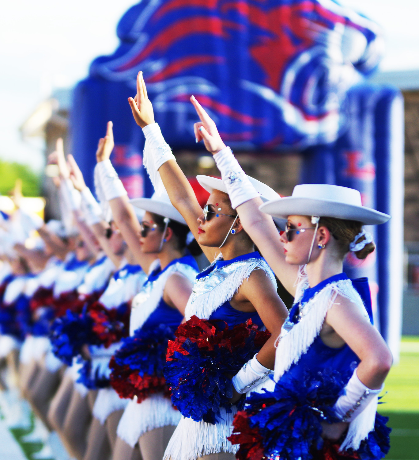 Leander High School Dance Teams salute for the school song at the beginning at the game against Weiss at the Pfield August 30, 2018.