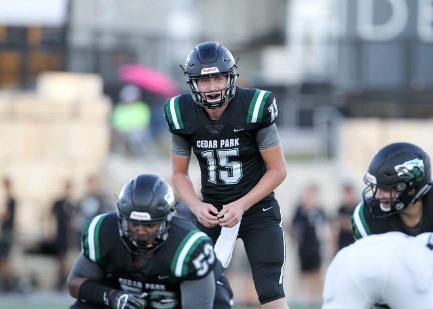 Cedar Park Timberwolves senior Ryan Fiala (15) prepares to take a snap during a high school football game between the Cedar Park Timberwolves and the Vandegrift Vipers on Friday, Aug. 31, 2018 in Cedar Park, Texas.