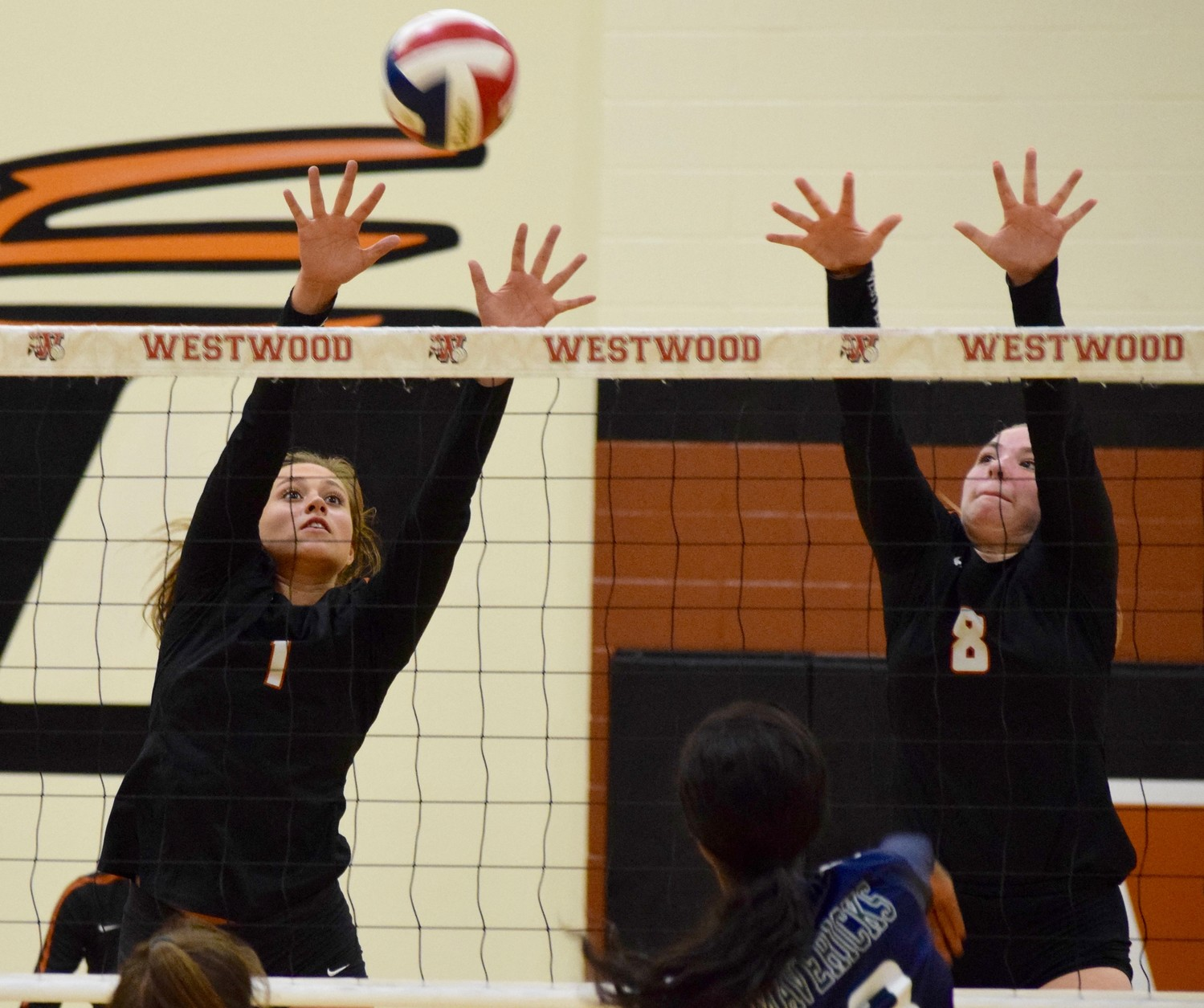Abby Gregorczyk, left, Caroline Suter and Westwood beat McNeil 3-1 (25-21, 25-17, 19-25, 28-26) on Tuesday night to remain one of two teams still undefeated in District 13-6A play.